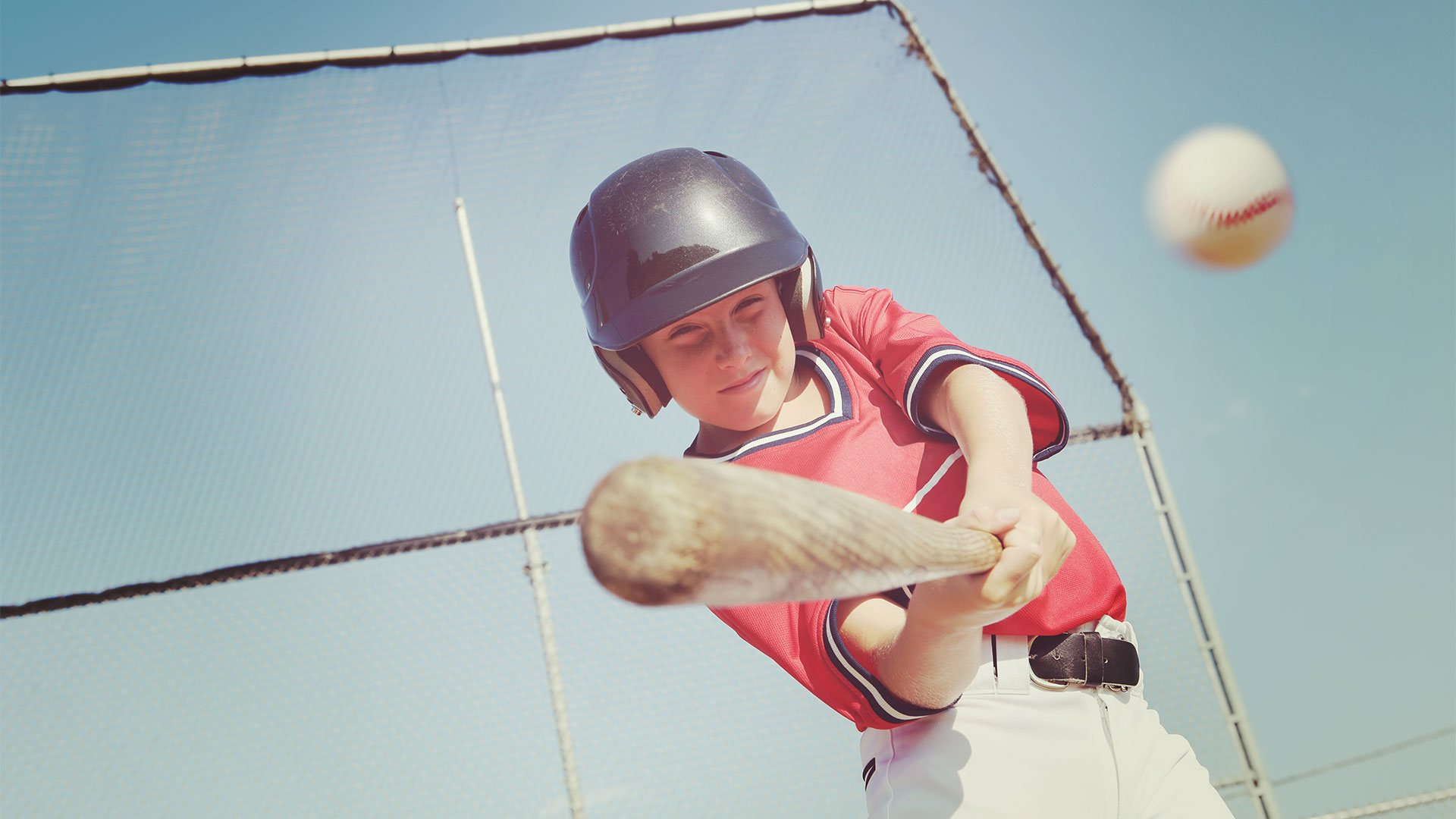 Youth baseball player batting